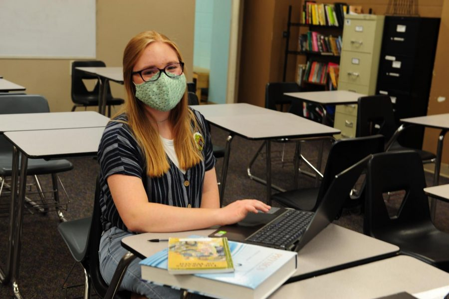 """Junior Elizabeth Riedel studies at a Speech and Debate meeting on October 6, 2020. She has learned to work especially hard in higher-level courses. """"Something I've learned from my current AP courses is that you can't just wing [an exam], you have to actually study,"""" she said."""