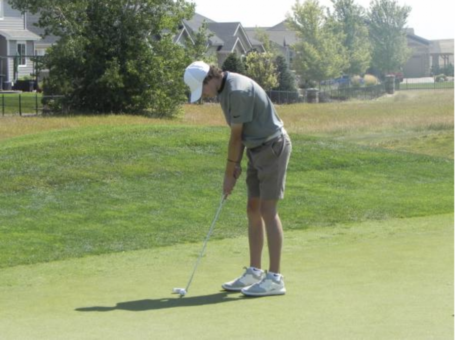 Puttin' in Effort: Owen Palasz sets up his putt on the greens. Eye on the ball, focus is key.