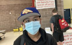 """Mask on. Freshman Evan Romero wears his mask before class starts on Sept. 14. Romero wears his mask as the mandate had made him. """"Because the mandate told me to,"""" Romero said when asked why he was wearing a mask."""