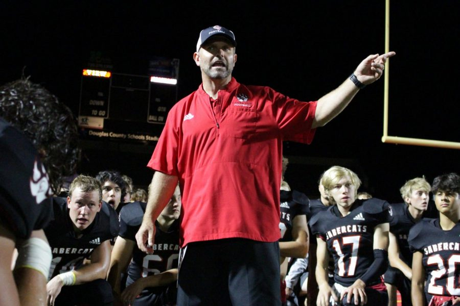 Ready for battle: On Sept. 17th, coach Eric Handke prepares his team for battle against the DOuglas County Huskies. With this long awaited rivalry, the boys are ready for a night to remember